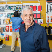 Confident Senior Worker Smiling In Hardware Store — Stock Photo