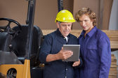 Workers Using Digital Tablet In Workshop — Stock Photo