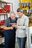 Salesman With Customer Using Digital Tablet — Stock Photo