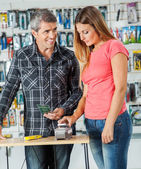Couple Paying Through Smartphone In Hardware Store — Stock Photo