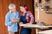 Carpenter With Senior Colleague Using Digital Tablet — Stock Photo