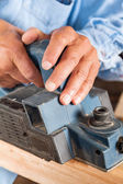 Carpenters Hands Shaving Wood With Electric Planer — Stock Photo