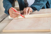 Male Carpenter Marking On Wood With Pencil — Stock Photo