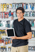 Man Showing Digital Tablet In Hardware Store — Stock Photo