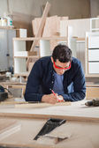 Carpenter Measuring Wood With Ruler And Pencil — Stock Photo