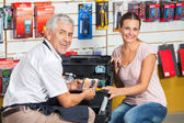 Salesman Assisting Woman In Hardware Store — Stock Photo