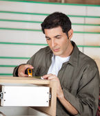 Carpenter Measuring Cabinet In Workshop — Stock Photo