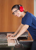 Happy Female Carpenter Using Tablesaw — Stock Photo