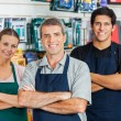 Salespeople Standing Arms Crossed In Hardware Shop — Stock Photo #50975527