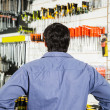 Rear View Of Customer Standing In Hardware Shop — Stock Photo #50975575