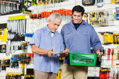 Father And Son Buying Tools In Hardware Store — Stock Photo