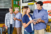 Couple Buying Tool Set In Hardware Store — Stock Photo
