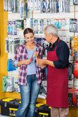 Salesman Assisting Customer In Buying Screwdriver At Store — Stock Photo