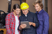 Male And Female Carpenters Using Digital Tablet — Stock Photo