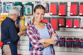 Confident Woman With Arms Crossed In Hardware Store — Stock Photo