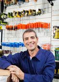 Happy Worker In Hardware Shop — Stock Photo