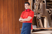 Confident Carpenter With Arms Crossed In Workshop — Foto Stock