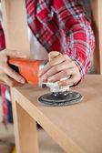 Carpenter Using Sander On Wooden Shelf — Stock Photo
