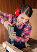 Carpenter Using Drilling Machine On Wood — Stock Photo