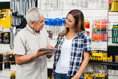 Family With Digital Tablet In Hardware Shop — Stock Photo