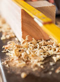 Closeup Of Plank And Scale In Workshop — Stock Photo