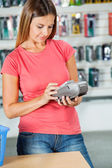 Woman Paying Through Smartphone In Hardware Store — Stock Photo