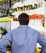 Rear View Of Customer Standing In Hardware Shop — Stock Photo