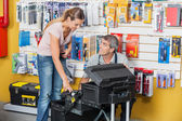 Salesman Guiding Customer In Selecting Tools At Store — Stock Photo