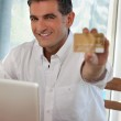 Man Making Online Purchases — Stock Photo #7745350