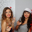 Girlfriends at christmas party - Stock Photo