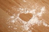 Heart shape made ??of flour — Stock Photo