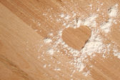 Heart shape made ??of flour — Stock Photo