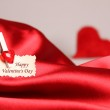 Greeting card for Valentine's Day, on red satin — ストック写真