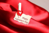 Greeting card for Valentine's Day, on red satin — Stock Photo