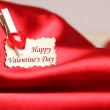 Greeting card for Valentine's Day, on red satin — Stock Photo #20133255