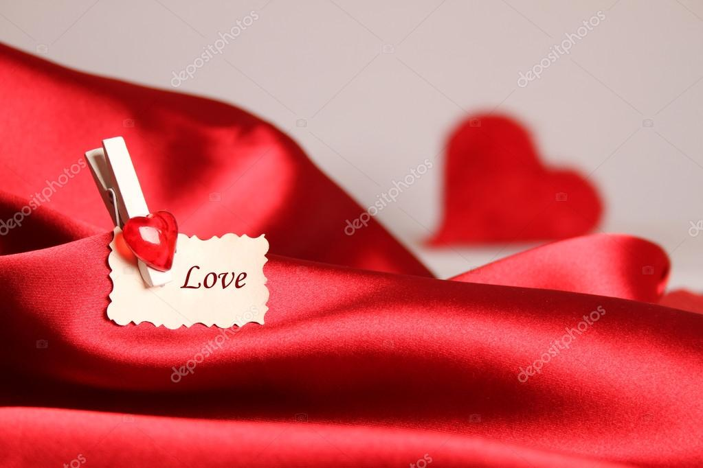 Gift card for Valentine's Day, on a red silk  Stock Photo #20133337