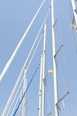Many masts against the sky — Stock Photo