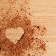 Heart shape made ??of cocoa — Stock Photo