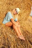 Beautiful woman near haystack — Stock Photo