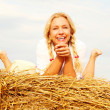 Beautiful woman near haystack — Stock Photo