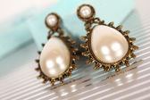 Earrings with pearls — Stock Photo