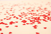 Red hearts background — Stock Photo