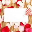 Card and rose petals — Stock Photo #6379184