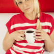 Attractive young woman drinking coffee at home — Stock Photo #6885868