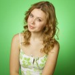 Beautiful young woman on green background — Stock Photo #8170477