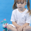 Small cute girl is posing on blue background — Stock Photo #3556795