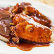 Pork ribs & chicken wings with bbq sauce — Stock Photo #13055036