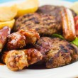 Mixed grill on a plate - Stock Photo