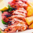 Royalty-Free Stock Photo: Prawn skewer with a side of baked potatoes