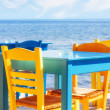 Greek restaurant by the sea - Stock Photo